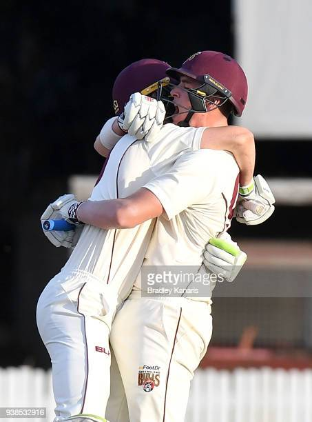 Matthew Renshaw and Marnus Labuschagne of Queensland celebrate victory during day five of the Sheffield Shield final match between Queensland and...
