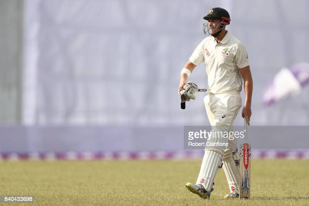 Matthew Renshaw of Australia walks off the ground after he was dismissed by Mehedi Hasan Miraj of Bangladesh during day three of the First Test match...