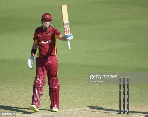 Matthew Renshaw of QLD celebrates making 50 during the JLT One Day Cup match between Queensland and the Cricket Australia XI at Allan Border Field on...