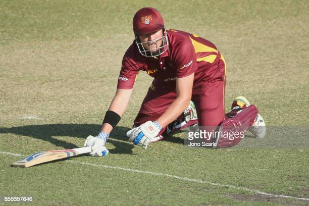 Matthew Renshaw of QLD is run out during the JLT One Day Cup match between Queensland and the Cricket Australia XI at Allan Border Field on September...