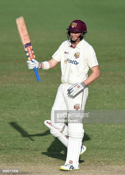 Matthew Renshaw of Queensland celebrates after scoring a half century of runs during day five of the Sheffield Shield final match between Queensland...