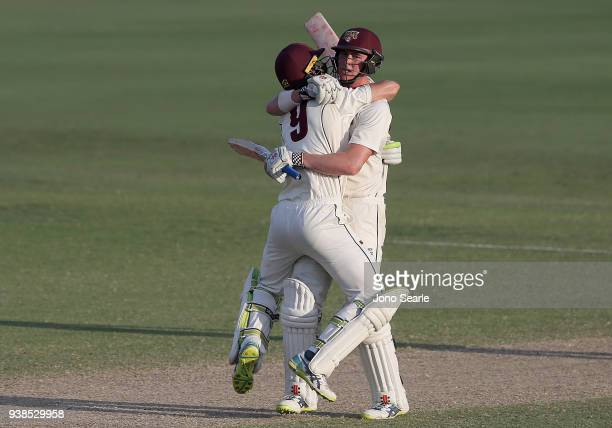 Matthew Renshaw of Queensland celebrates scoring the winning runs with team mate Marnus Labuschagne during day five of the Sheffield Shield final...