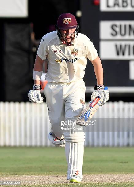 Matthew Renshaw of Queensland celebrates victory after hitting the winning runs during day five of the Sheffield Shield final match between...