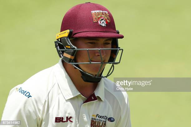 Matthew Renshaw of Queensland leaves the field after being dismissed during day one of the Sheffield Shield match between Queensland and New South...