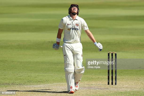 Matthew Renshaw of Queensland leaves the field after being dismissed by Doug Bollinger of New South Wales during day two of the Sheffield Shield...