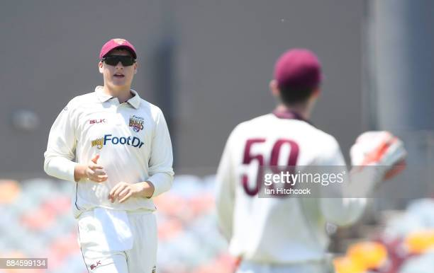 Matthew Renshaw of the Bulls speaks to his Captain Jimmy Peirson during day one of the Sheffield Shield match between Queensland and South Australia...