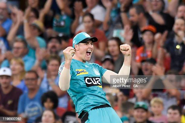 Matthew Renshaw of the Heat celebrates catching out Ashton Turner of the Scorchers during the Big Bash League match between the Brisbane Heat and the...