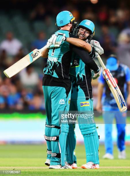 Matthew Renshaw of the Heat celebrates the winning runs with Alex Ross of the Heat during the Big Bash League match between the Adelaide Strikers and...