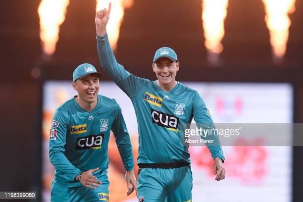 Matthew Renshaw of the Heat celebrates with Tom Banton after dismissing Matthew Wade of the Hurricanes during the Big Bash League match between the...