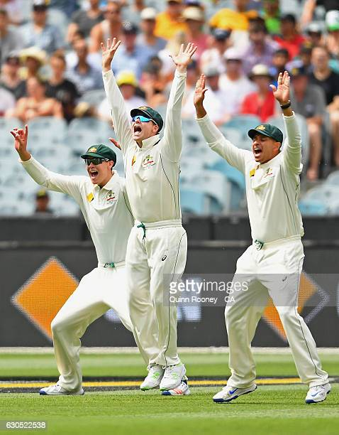 Matthew Renshaw Steve Smith and Usman Khawaja of Australia appeal for a wicket during day one of the Second Test match between Australia and Pakistan...