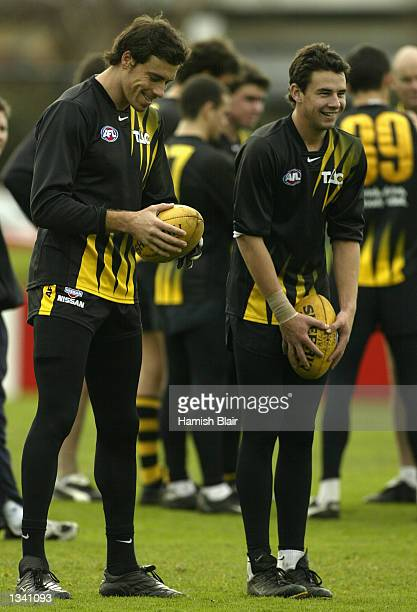 Matthew Richardson of Richmond shares a joke with team mate Andrew Mills during training at Punt Rd Oval Melbourne Australia on July 18 2002
