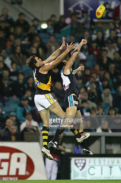 Matthew Richardson of the Tigers challenges Darryl Wakelin of the Power during the round 17 AFL match between the Port Adelaide Power and the...