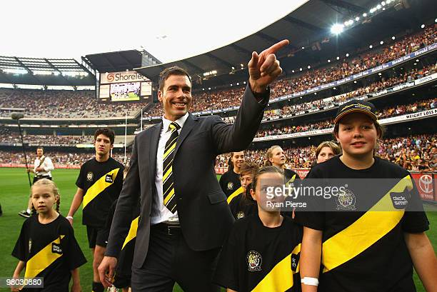 Matthew Richardson of the Tigers waves to fans during a farewell lap before the round one AFL match between the Richmond Tigers and Carlton Blues at...