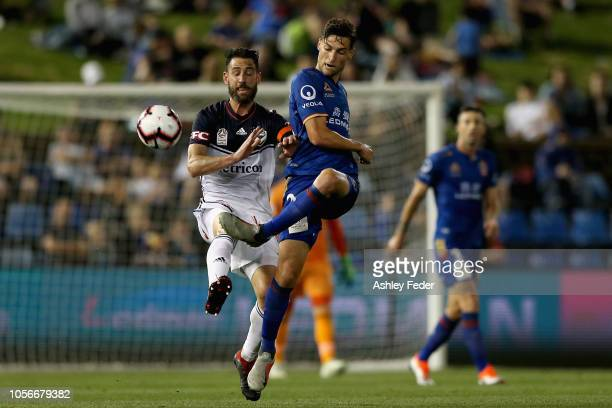 Matthew Ridenton of the Jets contests the ball against Melbourne Victory defence during the round three ALeague match between the Newcastle Jets and...