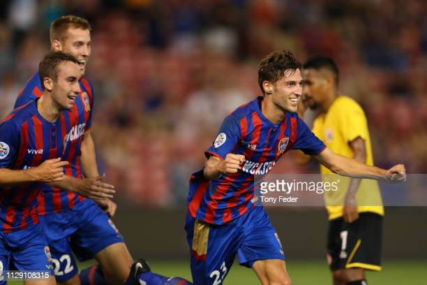 Matthew Ridenton of the Newcastle Jets celebrates a goal with team mates during the AFC Champions League Second Round Preliminary Stage match between...
