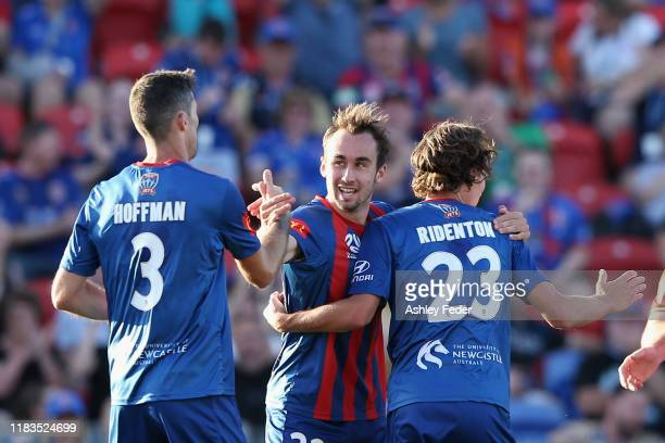 Matthew Ridenton of the Newcastle Jets celebrates with Angus Thurgate of the Newcastle Jet which turned out to be a no goal 'handball' during the...