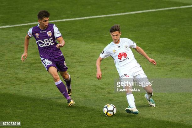 Matthew Ridenton of the Phoenix controls the ball under pressure from Brandon Wilson of the Glory during the round six ALeague match between the...