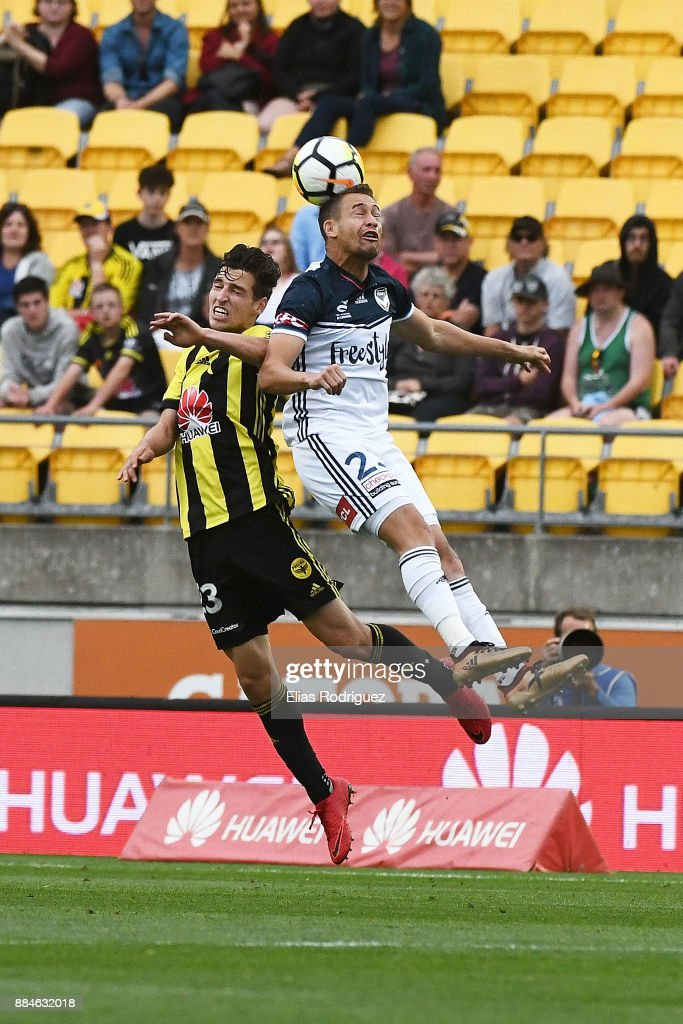 Matthew Ridenton of the Wellington Phoenix and Jai Ingham of Melbourne Victory contest for the ball during the round nine A-League match between the Wellington Phoenix and the Melbourne Victory at Westpac Stadium on December 3, 2017 in Wellington, New Zealand.
