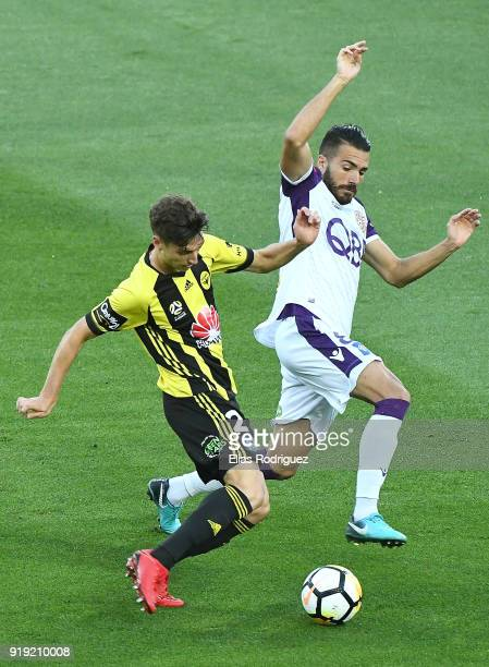 Matthew Ridenton of Wellington Phoenix tackled by Xavi Torres of Perth Glory during the round 20 ALeague match between the Wellington Phoenix and the...