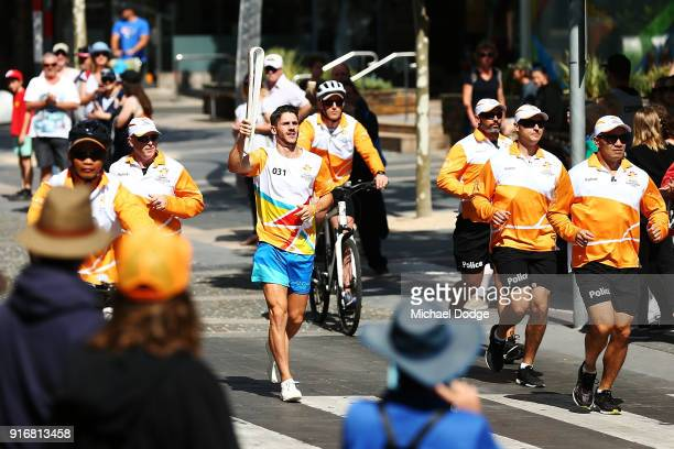 Matthew Rizzo carries the Queens Baton during the Queens Baton Commonwealth Games relay in Frankston on February 11 2018 in Melbourne Australia