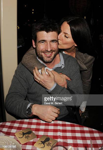 Matthew Robertson and Davina McCall attend the Centrepoint Ultimate Pub Quiz hosted by Kirsty Young at Shoreditch House on February 1 2011 in London...