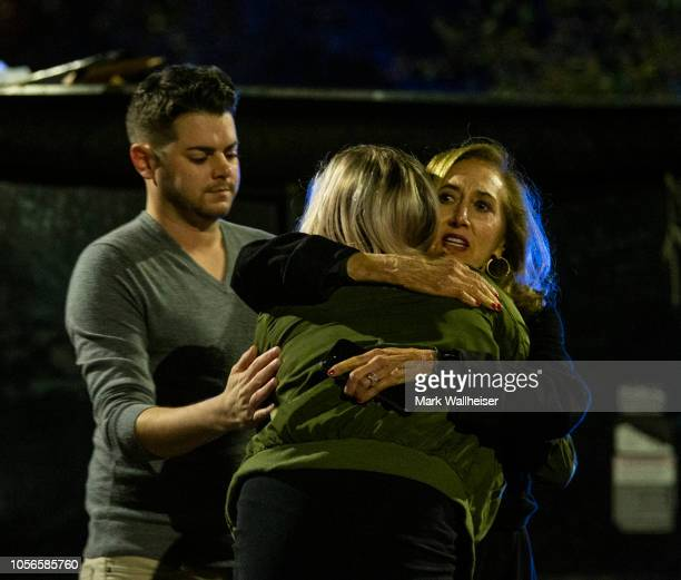 Matthew Rodin left and Susan Turner comfort Melissa Hutchinson who rendered aid to some of the victims of a mass shooting November 2 2018 in...