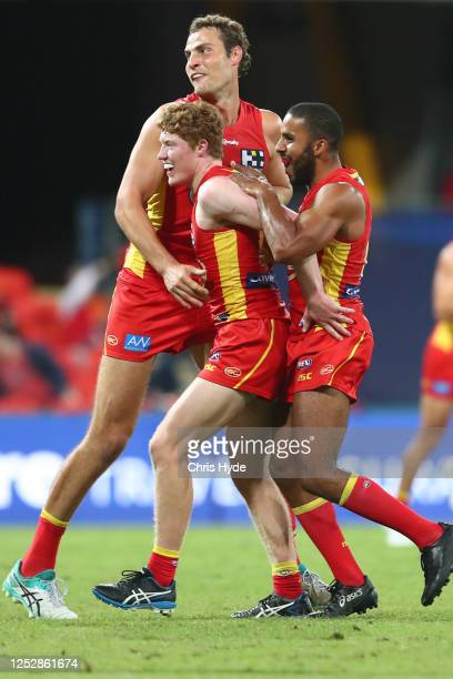 Matthew Rowell of the Suns celebrates a goal during the round 4 AFL match between the Gold Coast Suns and Fremantle Dockers at Metricon Stadium on...