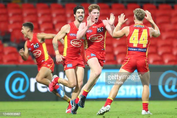 Matthew Rowell of the Suns celebrates his first goal during the round 2 AFL match between the Gold Coast Suns and the West Coast Eagles at Metricon...