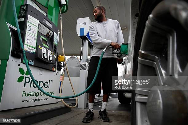 Matthew Rucker of Gardena pumps B20 biodiesel into his truck on Thursday morning at a Chevron station in Harbor City