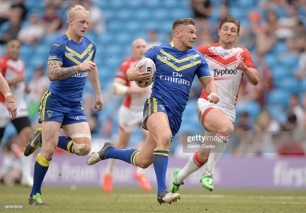 Matthew Russell of Warrington Wolves breaks free to score a second half try during the Super League match between Warrington Wolves and St Helens at Etihad Stadium on May 18, 2014 in Manchester, England.