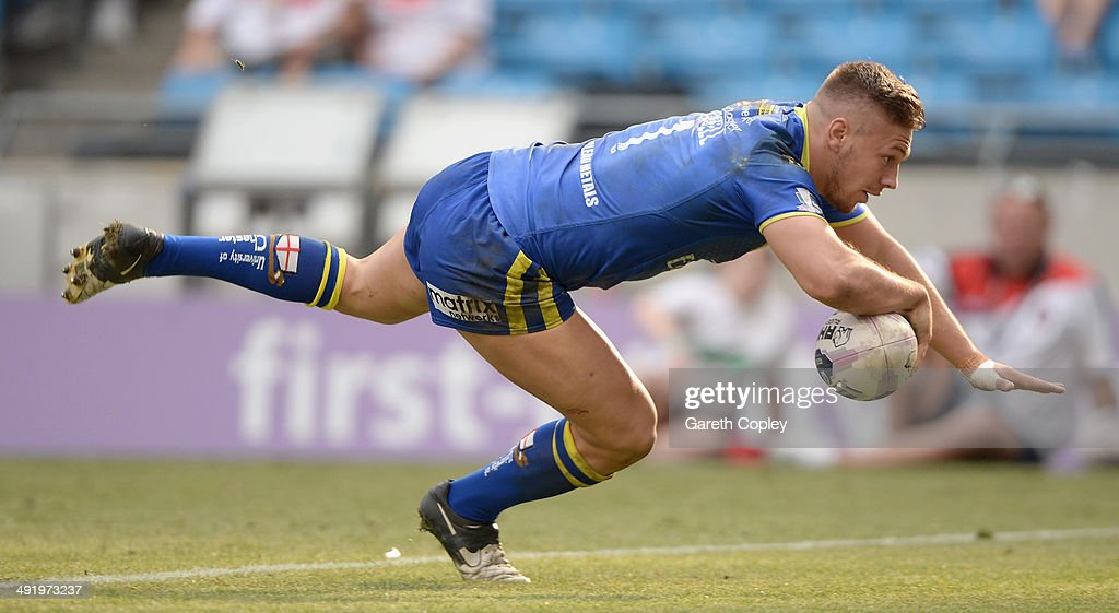 Matthew Russell of Warrington Wolves scores a second half try during the Super League match between Warrington Wolves and St Helens at Etihad Stadium on May 18, 2014 in Manchester, England.