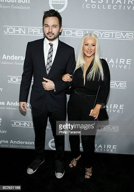 Matthew Rutler and singer Christina Aguilera attend the Fifth Annual Baby2Baby Gala Presented By John Paul Mitchell Systems at 3LABS on November 12...