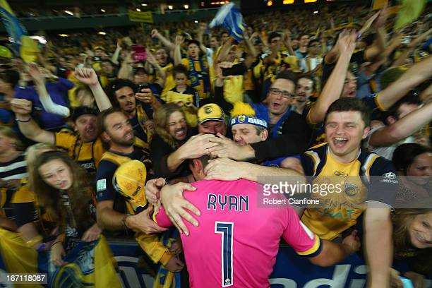 Matthew Ryan of the Mariners celebrates with fans after the Mariners defeated the Wanderers at the ALeague 2013 Grand Final match between the Western...