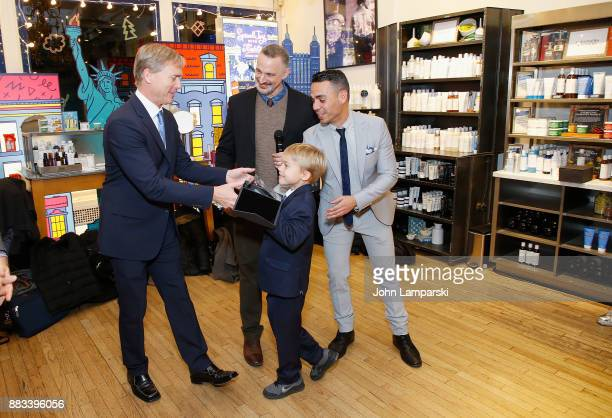 Matthew Saks and his son Brody Saks accept an award presented by Karl Siciliano and Alex Roque during The Bea Arthur Residence Building dedication on...