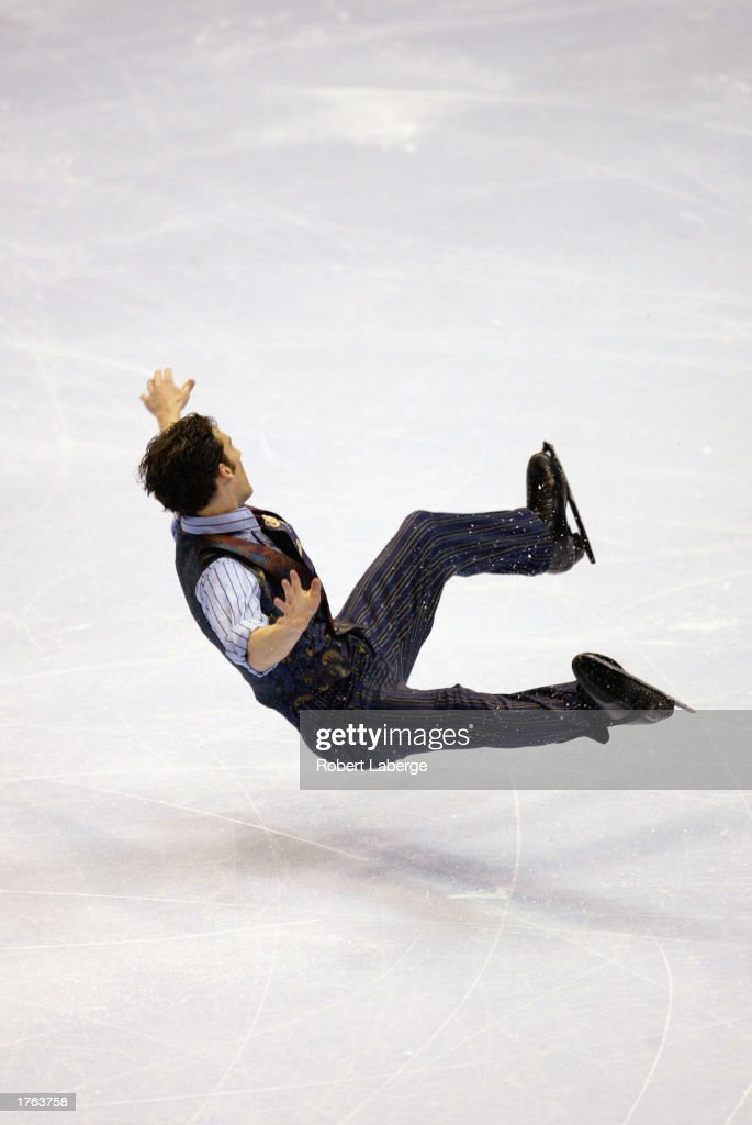 Matthew Savoie falls to the ice during the men's free skate program at the State Farm US Figure Skating Championships on January 18, 2003 at the American Airlines Center in Dallas, Texas.