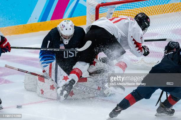 Matthew Savoie of Canada clashes with Goalkeeper Dylan Silverstein of United States during Men's 6Team Tournament Semifinals Game between United...