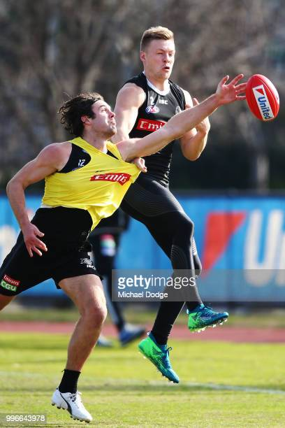Matthew Scharenberg of the Magpies competes for the ball against Jordan de Goey of the Magpies during a Collingwood Magpies AFL press conference at...