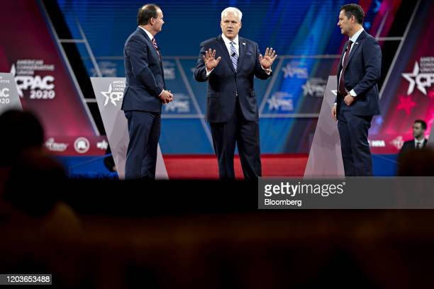 Matthew Schlapp, chairman of the American Conservative Union, center, speaks as Senator Mike Lee, a Republican from Utah, left, listens during a...