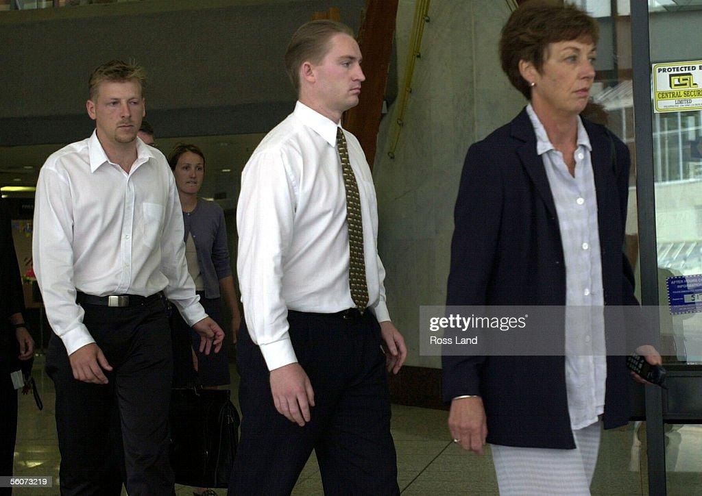 Matthew Schofield (center) leaves the Auckland Dis : News Photo