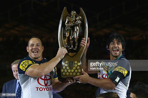 Matthew Scott and Johnathan Thurston of the Cowboys hold the Premiership trophy aloft as they celebrate victory during the 2015 NRL Grand Final match...