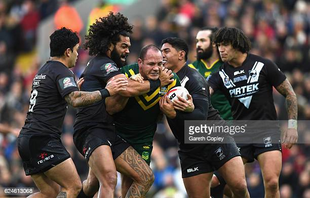 Matthew Scott of Australia is held up by the New Zealand defence during the Four Nations Final between New Zealand and Australia at Anfield on...