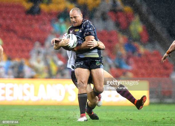 Matthew Scott of the Cowboys attempts to break through the defence during the NRL trial match and Jonathan Thurston/Cameron Smith Testimonial match...