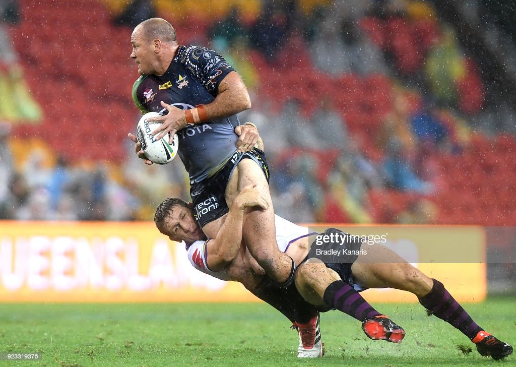 Matthew Scott of the Cowboys attempts to break through the defence during the NRL trial match and Jonathan Thurston/Cameron Smith Testimonial match between the Melbourne Storm and the North Queensland Cowboys at Suncorp Stadium on February 23, 2018 in Brisbane, Australia.