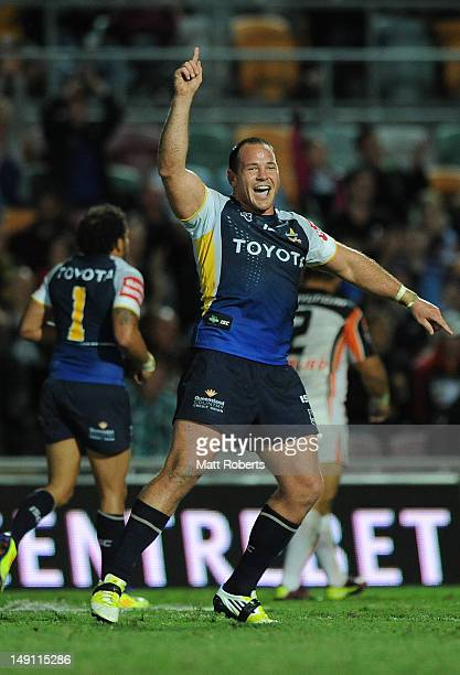 Matthew Scott of the Cowboys celebrates during the round 20 NRL match between the North Queensland Cowboys and the Wests Tigers at Dairy Farmers...