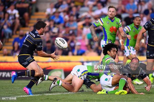 Matthew Scott of the Cowboys gets a pass away to Lachlan Coote for him to score a try during the round one NRL match between the North Queensland...