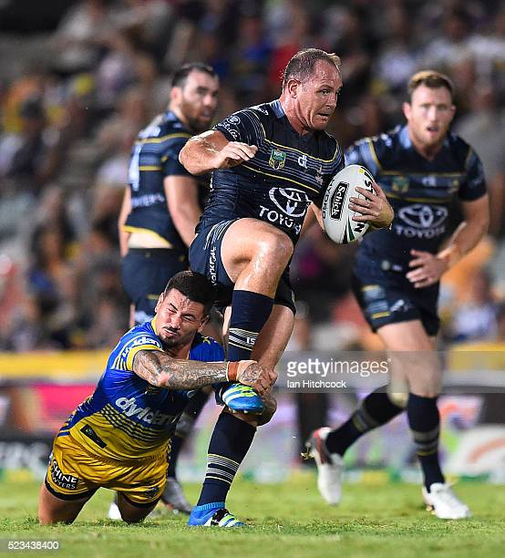 Matthew Scott of the Cowboys is tackled by Nathan Peats of the Eels during the round eight NRL match between the North Queensland Cowboys and the...