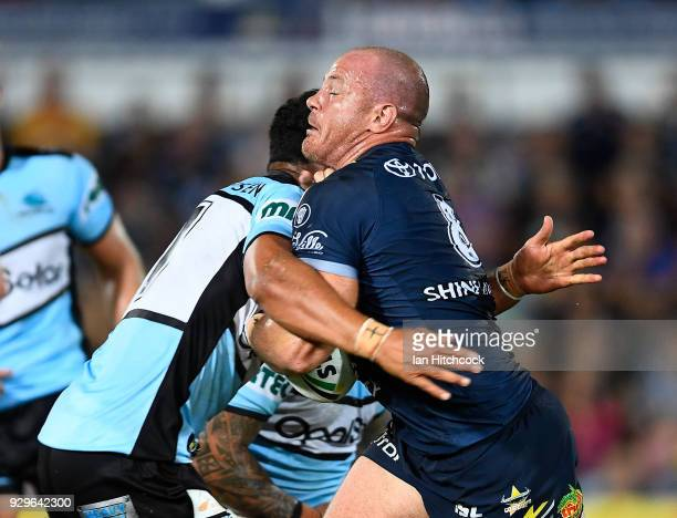 Matthew Scott of the Cowboys is tackled during the round one NRL match between the North Queensland Cowboys and the Cronulla Sharks at 1300SMILES...
