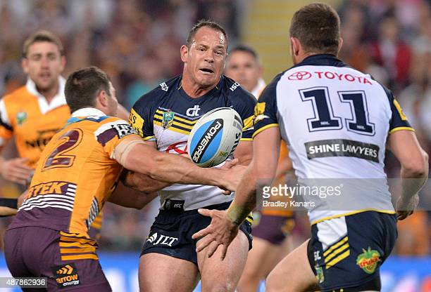 Matthew Scott of the Cowboys passes the ball during the NRL Qualifying Final match between the Brisbane Broncos and the North Queensland Cowboys at...