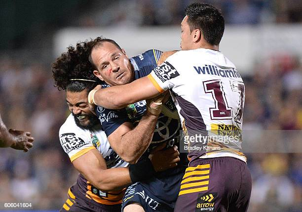 Matthew Scott of the Cowboys takes on the defence during the first NRL semi final between North Queensland Cowboys and Brisbane Brisbane at...