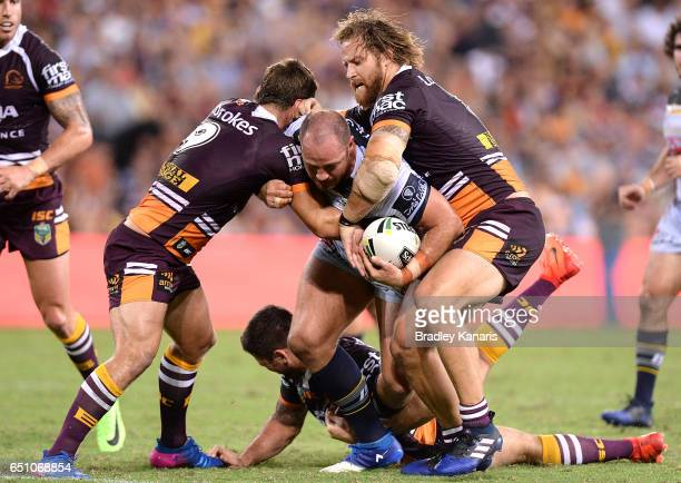Matthew Scott of the Cowboys takes on the defence during the round two NRL match between the Brisbane Broncos and the North Queensland Cowboys at...